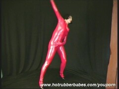 Brunette Xenia in latex catsuit Thumb