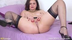 Naughty Busty brunette strips and wanks in sheer nylon heels Thumb