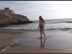 Blonde Aude naked in the ocean and beach Thumb