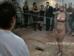 Cute blonde girl shackled in a dungeon Thumb