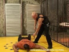 Cruel guard wrestles and fucks Thumb