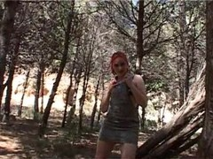 Sabrina strips in the woods Thumb