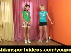 Shy brunette getting undressed by lesbian coach Thumb