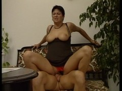Short haired lady sits on a cock Thumb