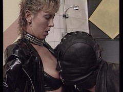 Biker couple enjoys leather costumes and fucking in the bathroom. Thumb