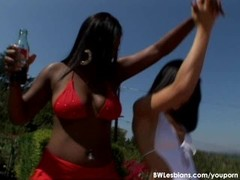 Open-air interracial lesbian sex under the hot sun Thumb