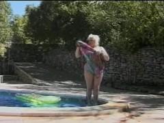 Busty blonde BBW near the pool Thumb