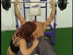 Redhead fucks a cock in the gym Thumb