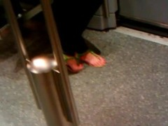 Feet in a metro train Thumb