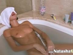 Petite german girl in the hot bath Thumb