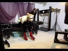 Naughty domina in latex makes her attractive slave suck her strap on Thumb