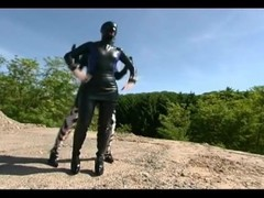 Domina and her passionate slave girl are outside having some hot time Thumb