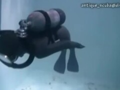 ''Female wetsuit diver swims erotically around bikini scuba girl'' Thumb