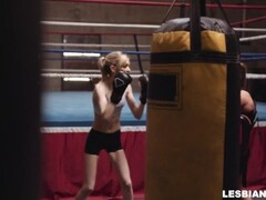 Slim blonde is fucked hard with a dildo by her lesbian boxing coach Thumb